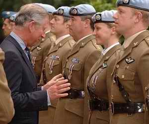 Charles inspecting the troops particular attention on a woman soldier
