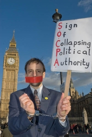 Protester with SOCPA banner