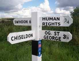 sign post Swindon 6 miles, the othe way to Huma Rights