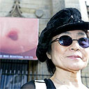 Yoko Ono and a picture of a large breast